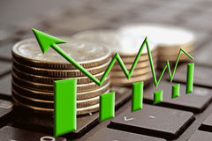 The green arrow on the background of money . Royalty Free Stock Photo