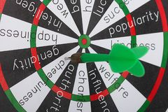Green arrow Darts. That fall in the sector`s cheerfulness Stock Images