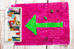 Green arrow on pink background Stock Photos