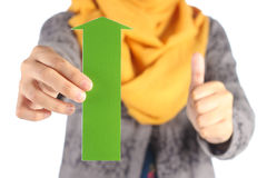 Green arrow with thumbs up sign Stock Image