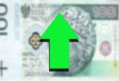 Green arrow up on polish money background Royalty Free Stock Image