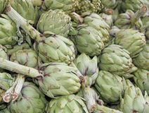 Green artichokes for sale at vegetable market 3 Stock Image
