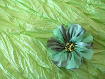 Green artificial fabric flower Stock Image