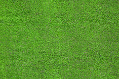 Green artificial grass plat. A green artificial grass for sports fields, covering, gardens. Plastic or grass background texture Stock Image