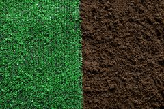 Green artificial grass on soil, top view. Gardening stock images
