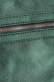 Green artificial leather with zipper for background stock photos