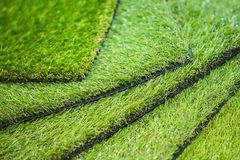 Green artificial turf. Examples of artificial turf, floor coverings for playgrounds. Green artificial turf. Probes examples of artificial turf, floor coverings Stock Images