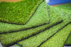 Green artificial turf rolled. Probes of artificial turf, floor coverings for playgrounds. Green artificial turf rolled. Probes examples of artificial turf Stock Photography