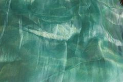 Green artistic fabric texture background / Artistic fabric textured, pattern, background with brightness royalty free stock images