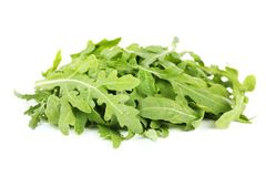 Green arugula leafs. Isolated on white background royalty free stock photography