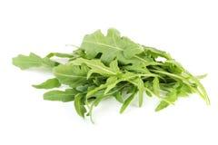 Green arugula leafs. Isolated on white background royalty free stock photo