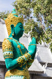 Green asian angel sculpture wearing golden jewelry Royalty Free Stock Image