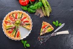 Green asparagi Tart with eggs and tomato Stock Photo