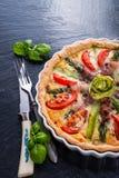 Green asparagi Tart with eggs and tomato Royalty Free Stock Photos