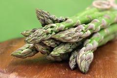 Green asparagus. Fresh green asparagus on cutting board Stock Photography