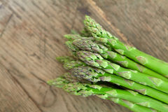 Green asparagus. Green asparagus on a wooden table Stock Image