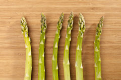 Green asparagus. A few green asparagus on a wooden background Royalty Free Stock Photos