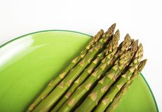 Green asparagus. Bunch of asparagus on plate royalty free stock image