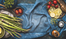 Green Asparagus And Vegetables Cooking Ingredients On Dark Blue Rustic Background, Top View