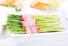 Green asparagus with bacon Royalty Free Stock Photography