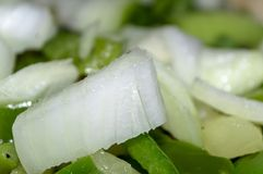 green asparagus beans and onions cut into small pieces, close-up Royalty Free Stock Image