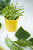 Green asparagus beans in a yellow cup Stock Photos