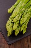 Green asparagus on black slate Stock Images