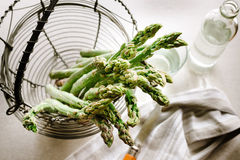 Green asparagus on board. Green asparagus of the basket Stock Images