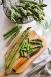 Green asparagus on board. Green asparagus on cutting board Royalty Free Stock Photos