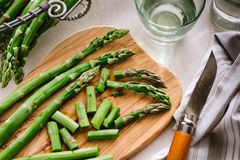 Green asparagus on board. Green asparagus on cutting board Royalty Free Stock Photo