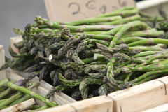 Green asparagus in box at farmers market Stock Photos