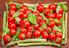 Green asparagus and cherry tomatoes Royalty Free Stock Image