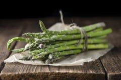 Green Asparagus (close-up shot) on wood Royalty Free Stock Image