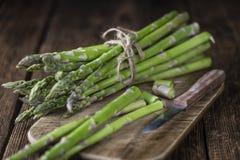 Green Asparagus (close-up shot) on wood Royalty Free Stock Photo