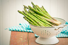 Green asparagus in colander Stock Photography