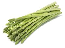 Green asparagus diagonal bunch isolated on white background. As package design element royalty free stock photography