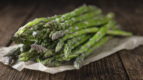 Green Asparagus. (fresh harvested) on an old wooden table (selective focus royalty free stock photo