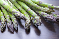 Green asparagus. Fresh green asparagus on rustic background Stock Image