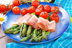 Green asparagus with ham and grilled cherry tomato Royalty Free Stock Photo