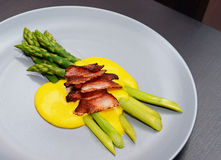 Green asparagus with Hollandaise sauce Stock Images