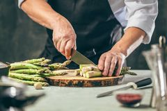 Green asparagus kept in men`s Chef cook hands stock images