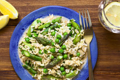 Green Asparagus, Pea and Brown Rice Risotto Stock Images