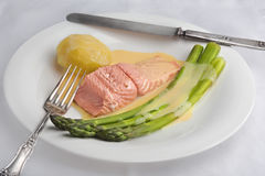 Green asparagus and poached salmon with sauce maltaise (hollanda Stock Image
