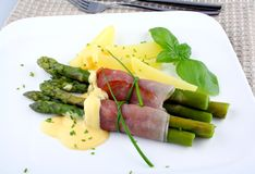 Green asparagus with potato, ham and sauce Stock Images