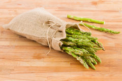 Green asparagus pouch  on table Royalty Free Stock Photos