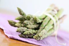 Green asparagus on purple napkin Royalty Free Stock Photo