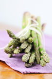 Green asparagus on purple napkin Stock Photo