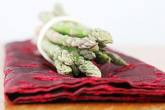 Green asparagus on red napkin Stock Photography