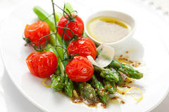 Green asparagus with roasted tomatoes Royalty Free Stock Image