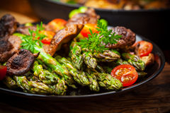 Green asparagus salad with roasted mushrooms Royalty Free Stock Photos